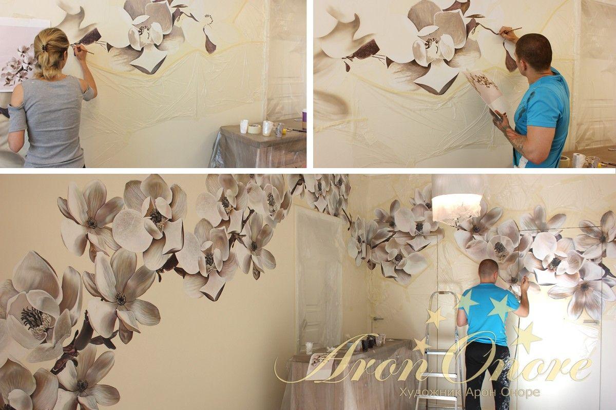 художник Арон Оноре рисует на стенах цветы
