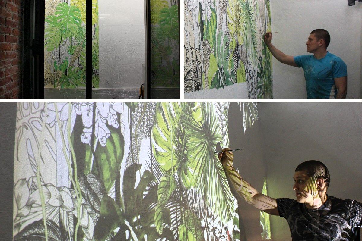 Процесс рисования на стене через проектор