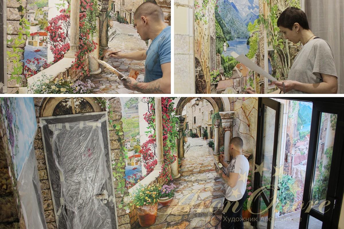Художник рисует на стене Арон Оноре